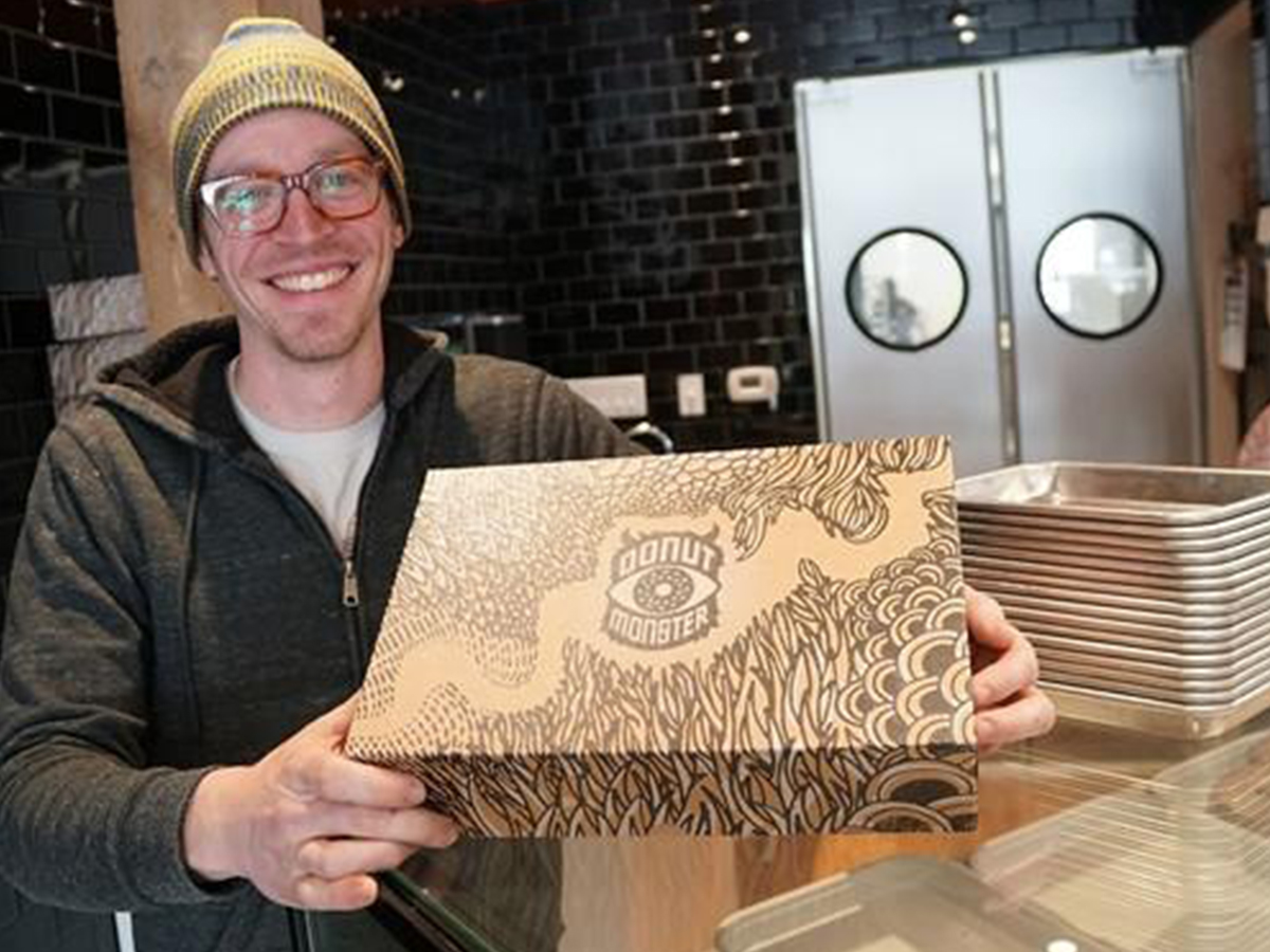 Picture of Man smiling holding box with glasses