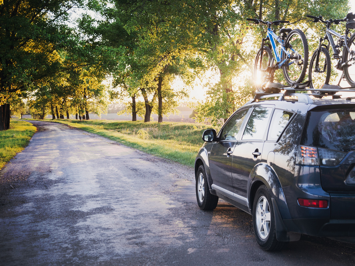 picture of moving car with two bike on the rack