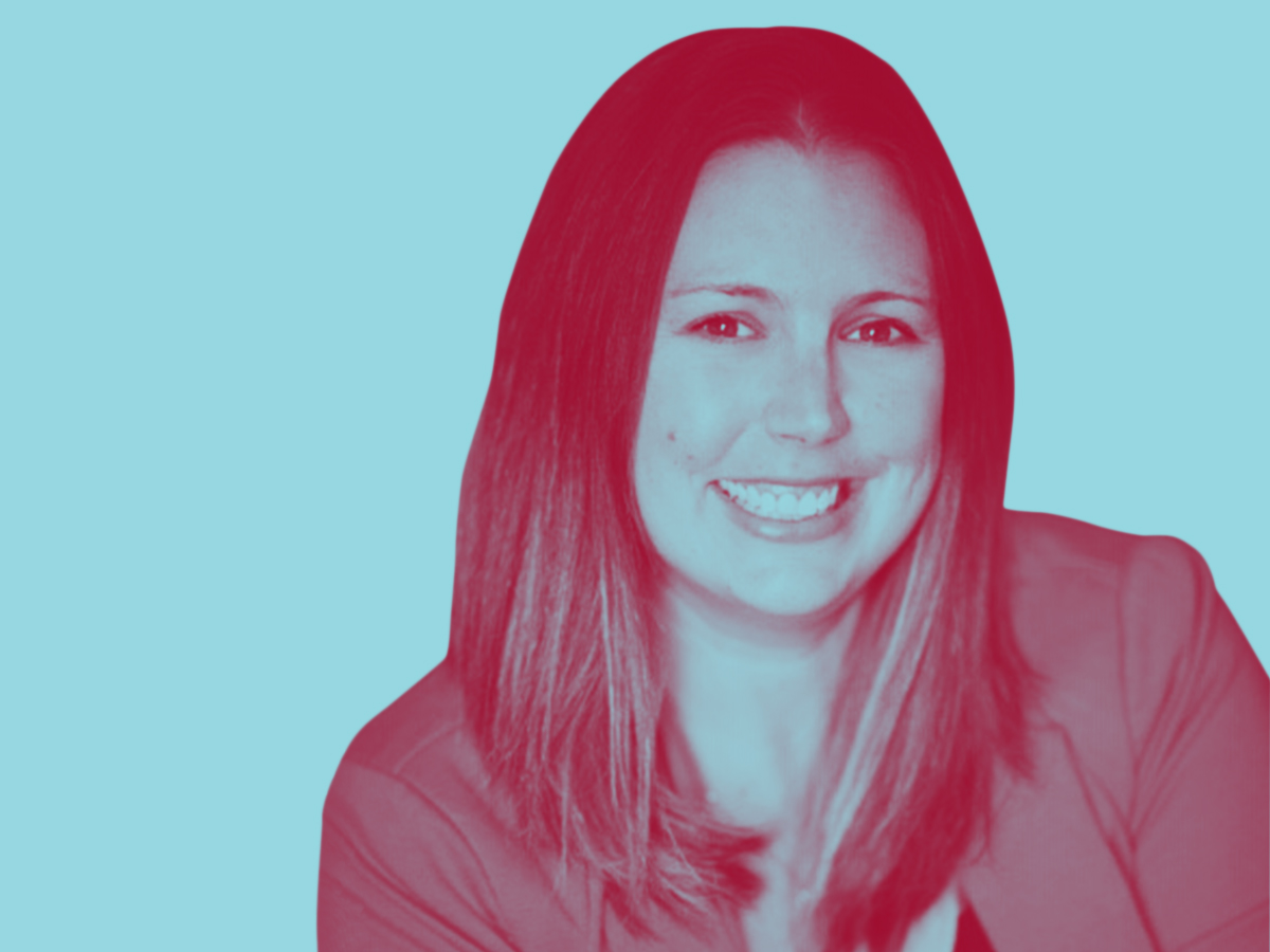 picture of Carrie Dunning smiling with a turquoise tint
